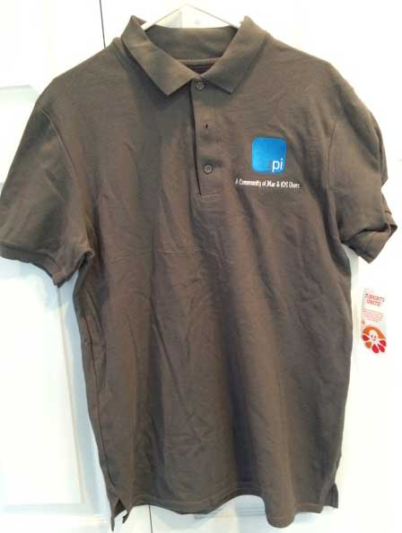 Washington Apple Pi polo shirt, now available. Though it isn't clear in the photo, the shirts are gray. For those in Britain, the shirts are grey.